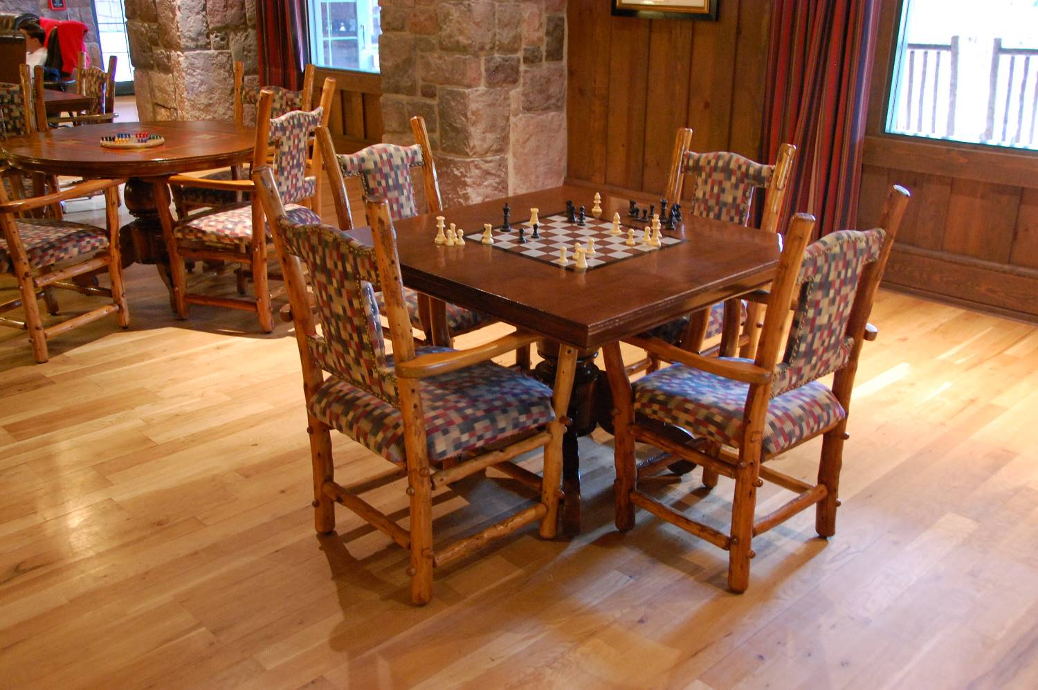 Enjoy time with family or a quiet game of checkers in the Carolwood Pacific room at the Villas at Disney's Wilderness Lodge in the Walt Disney World Resort in Florida.
