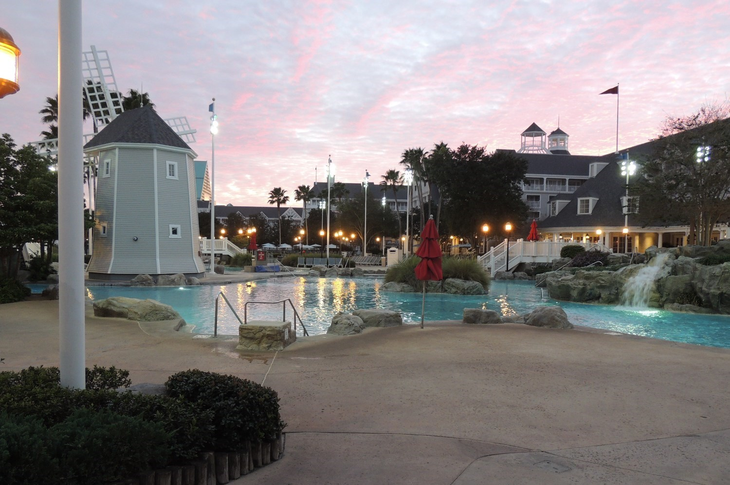 Disney's Yacht Club Storm Along Bay Feature Pool in the evening