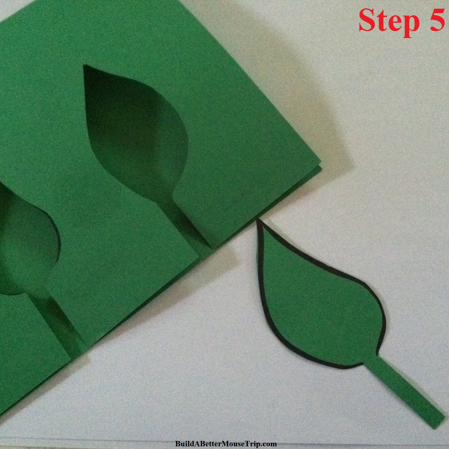 Step 5 - Cut a leaf out of green construction paper.