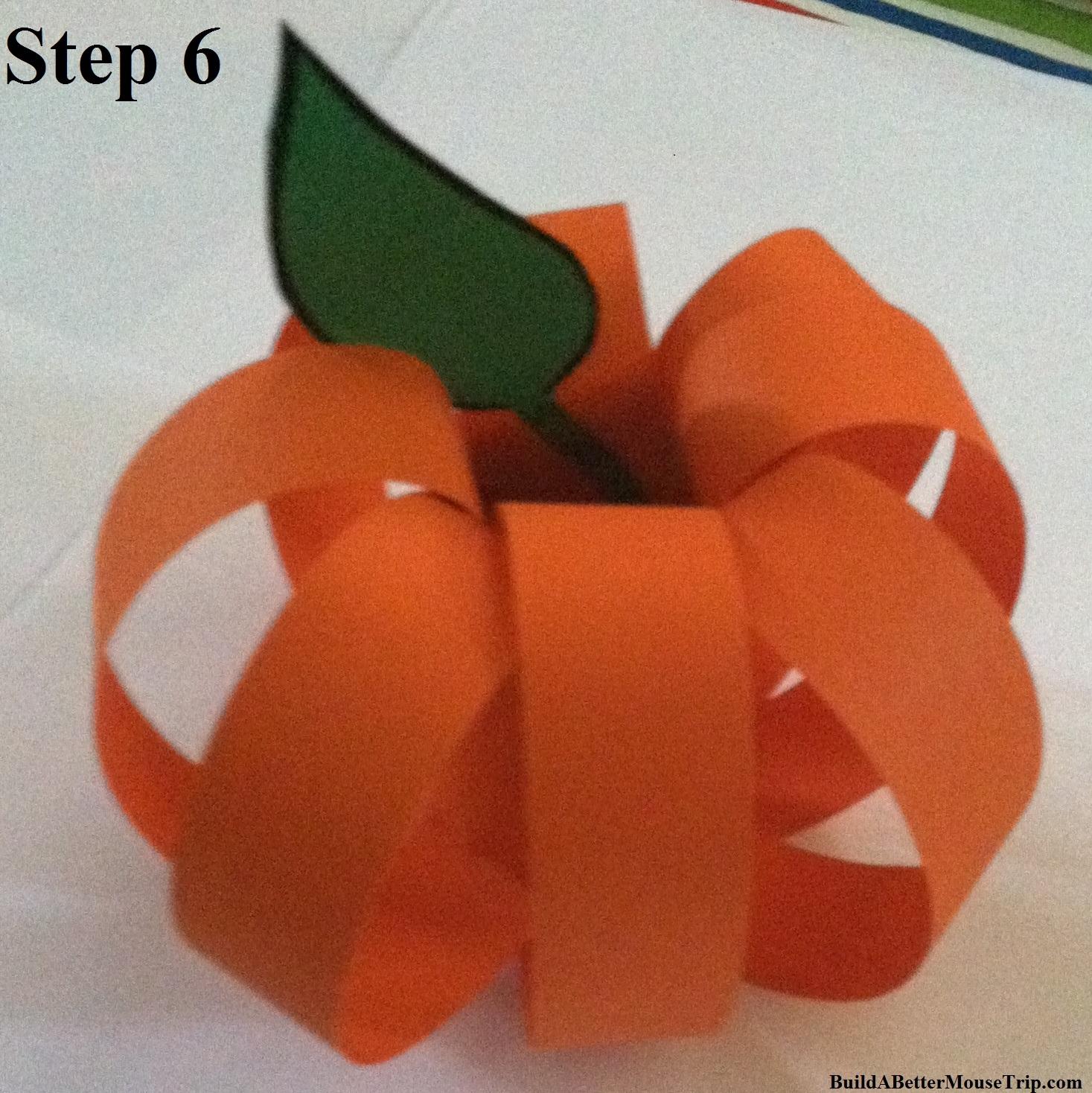 Step 6 - Add a leaf to your paper jack-o-lantern.