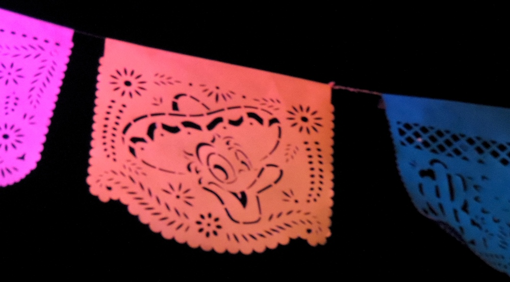"Donald Duck  Papel Picado  (punched or ""peckered"" tissue paper banner) in the    Gran Fiesta Tour with the Three Amigos"" ride in the Mexico pavilion at Epcot"