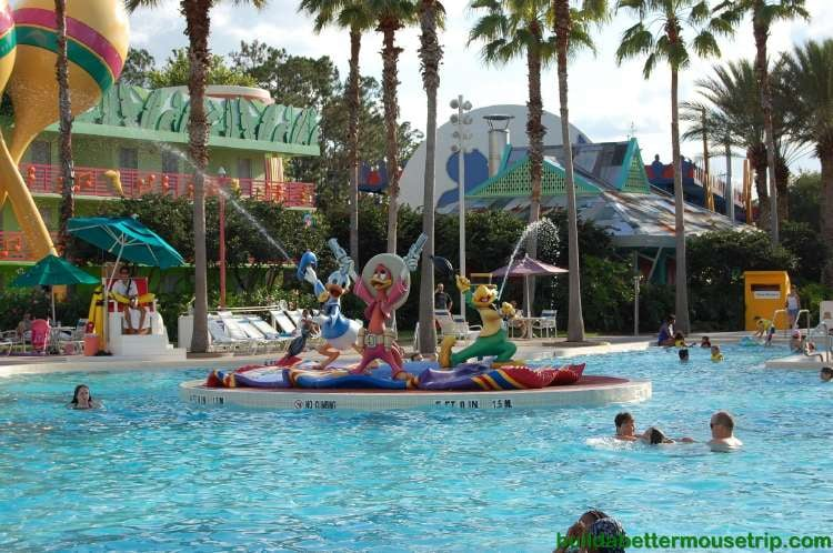 The Three Caballeros spray water at the guitar shaped Calypso Pool - Disney's All-Star Music Resort