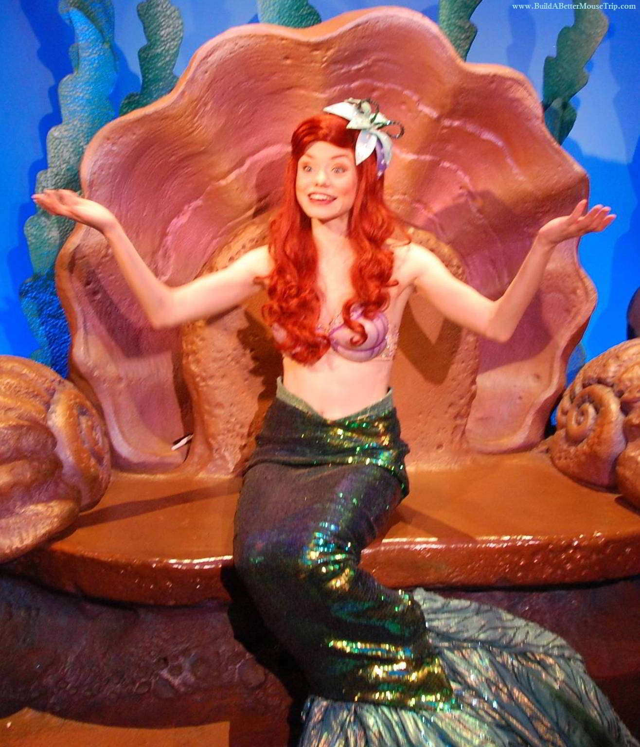 Ariel (The Little Mermaid) poses for photos and signs autographs at her grotto in the Magic Kingdom.