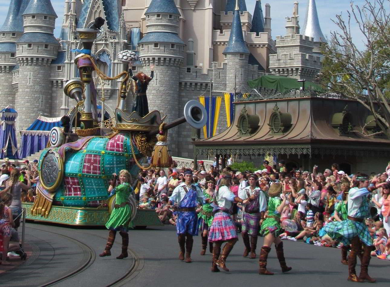 Brave   float featuring  Merida  in the  Festival of Fantasy Parade  in the  Magic Kingdom  at  Disney World .