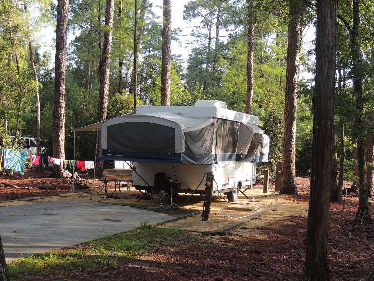 Disney's Fort Wilderness Resort & CAmpground features campsites for RVs, Pop-up tent trailers, and tents in a beautiful setting near the Magic Kingdom.