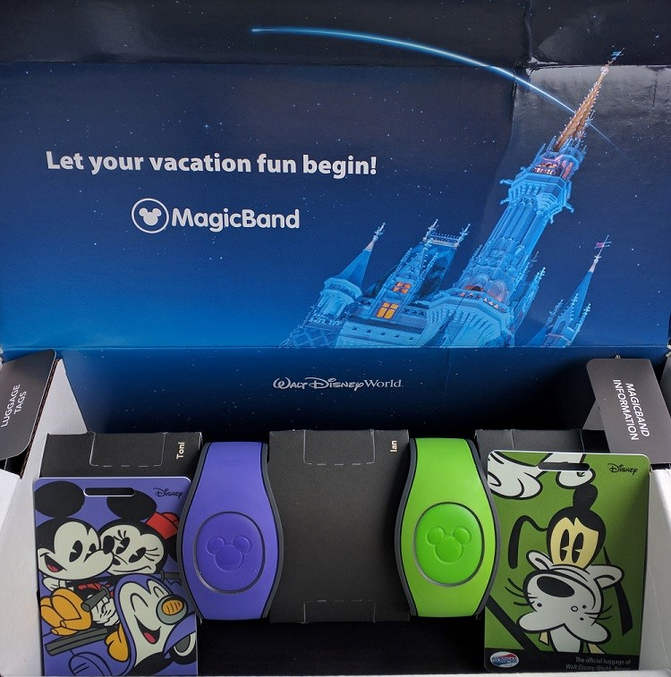 """A Comparison of the the """"New"""" and Old"""" Disney World Magic Bands - The new bands with their matching Disney character luggage tags in the original packaging."""