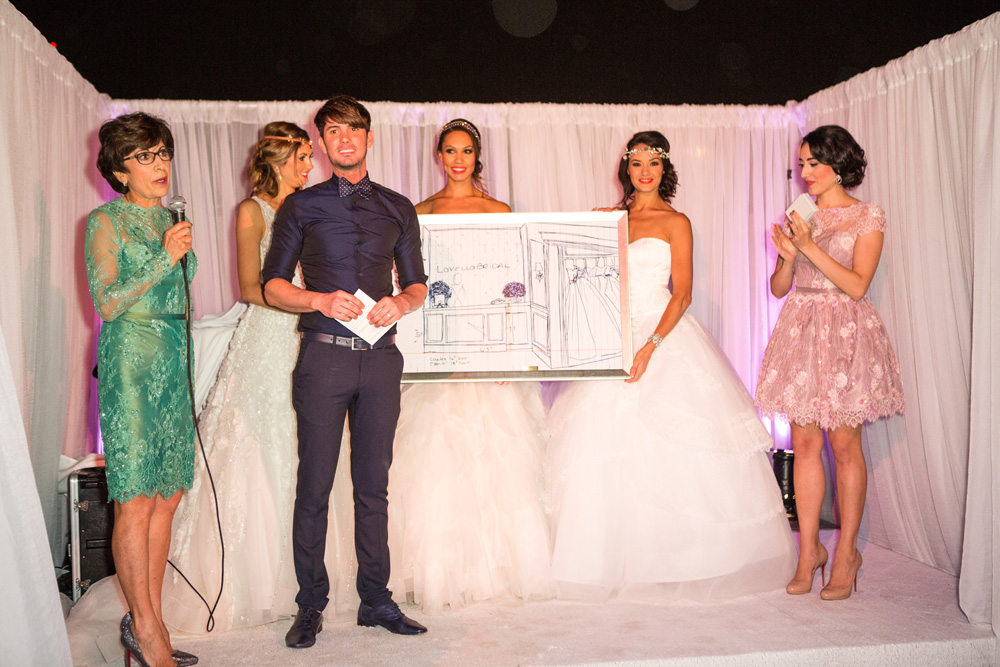 The handsome and stylish Jorge Manuel received a large-scale rendering of his original drawing of the Lovella Bridal new store design while Angie and Nayri of Lovella wore colorful lace cocktail dresses created by the famed designer.