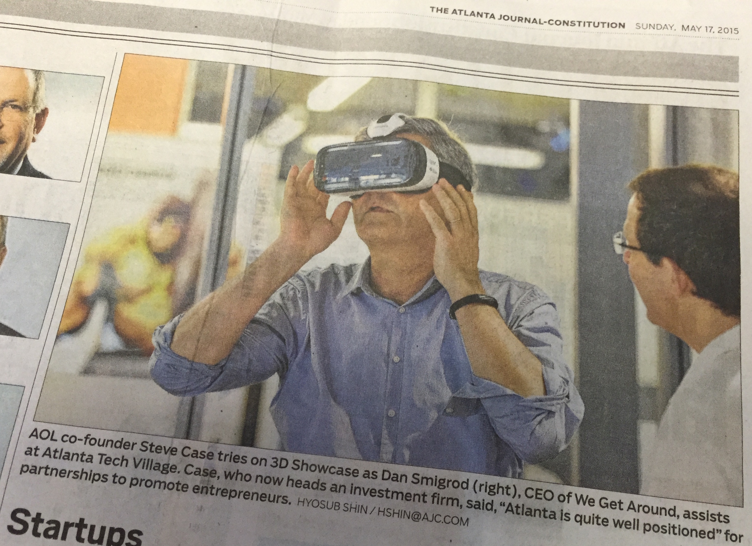 We Get Around Founder, CEO and Chief Photographer Dan Smigrod (right) demos Matterport Virtual Reality to AOL co-founder Steve Case. Image courtesy of the  Atlanta Journal=Constitution  | Photographer Hyosub Shin