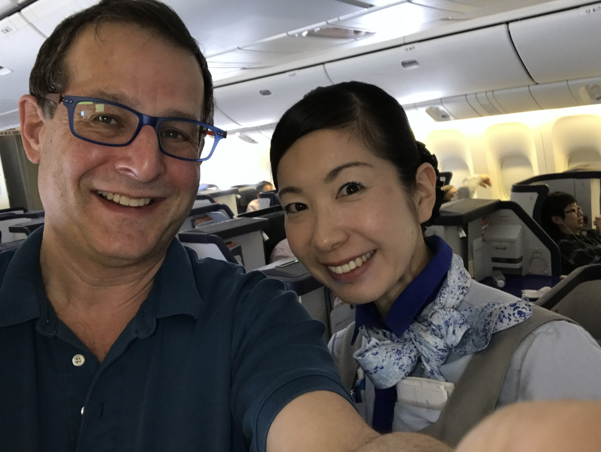 Photo: We Get Around Network Founder Dan Smigrod and ANA Flight Attendant Ms. Sugita. Image by We Get Around Chief Photographer Dan Smigrod