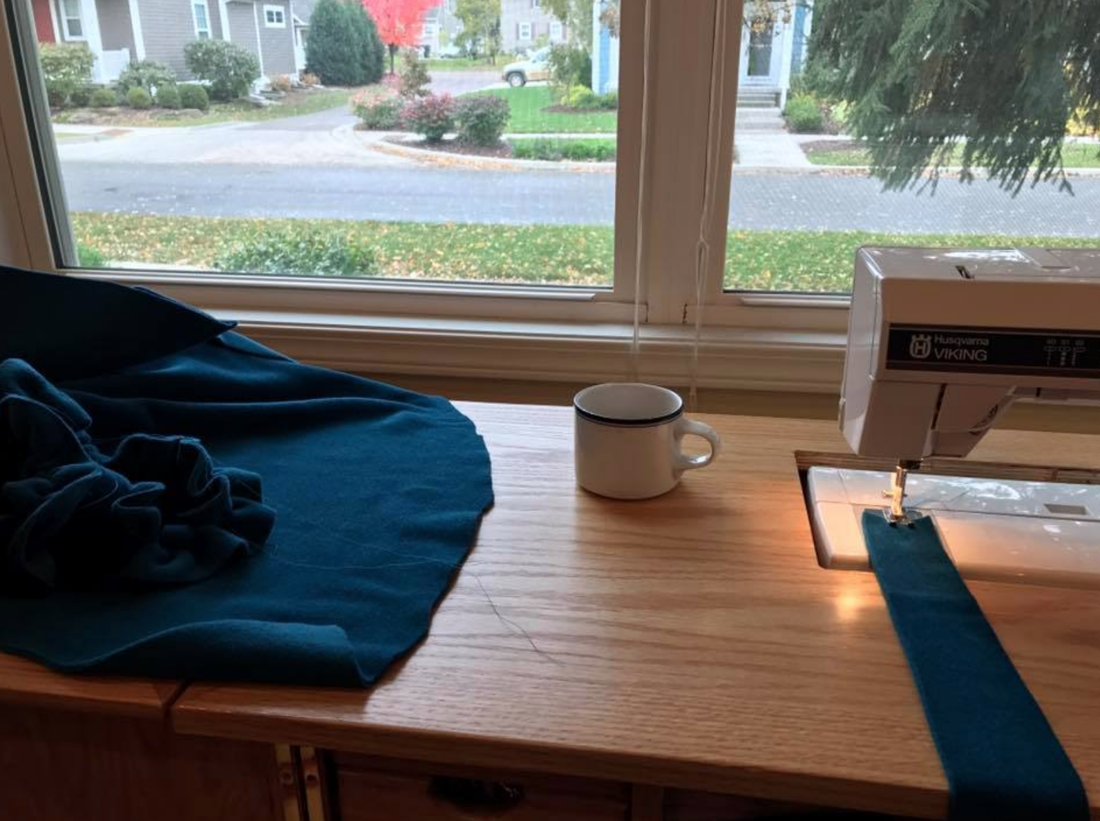 """All the bad things are happening in this photo. See if you can spot them all!  Hint: coffee, dangling threads, and not seen, other things on the sewing room table. In all fairness, the coffee was staged for this shot saved to Facebook and Instagram for a """"Sewing Sunday"""" post. The coffee generally gets moved off the sewing table lest it go flying during stitching!"""