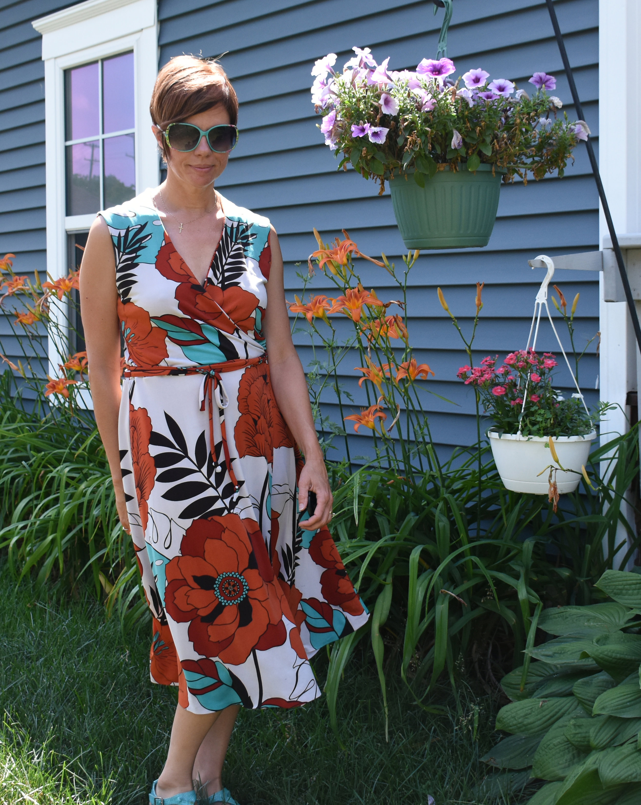 My side yard, against my garage, with flowers. I feel least self-conscious here. Christine Jonson Wrap dress with sleeveless, self-lined bodice. I'm not wearing enough lipstick here.