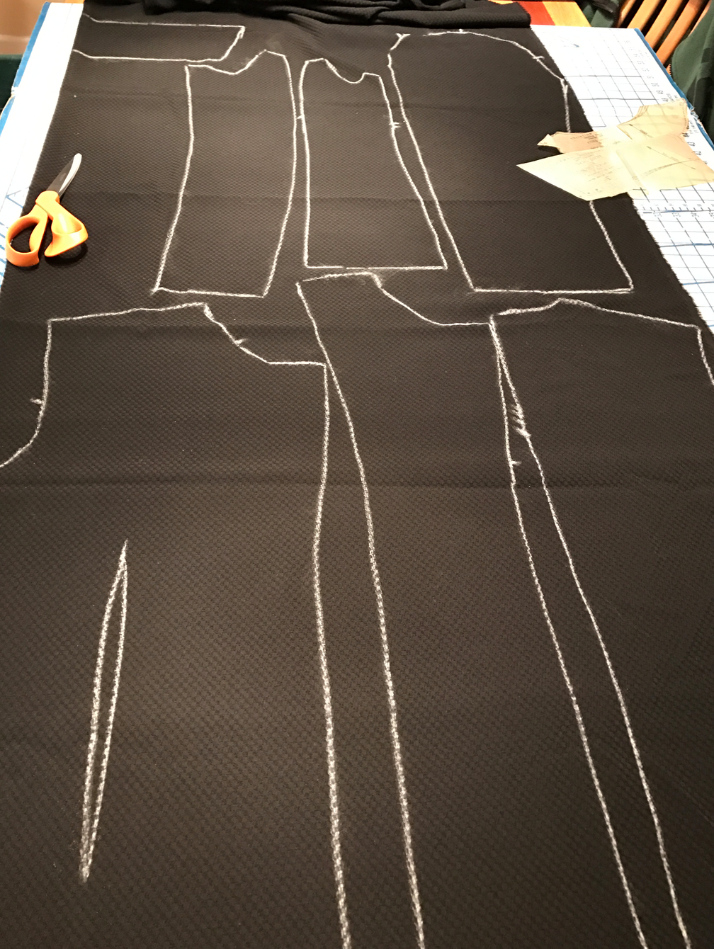 """Chalk-tracing your pattern pieces on to your fabric before cutting allows you all sorts of possibilities, including adjusting (slightly) the size by cutting on the outside of the chalk line or inside of the chalk line, as well as creating the dart """"seam"""" as Christine describes in this article."""