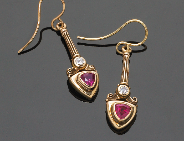 Custom earrings with trilliant cut rubies and diamonds.