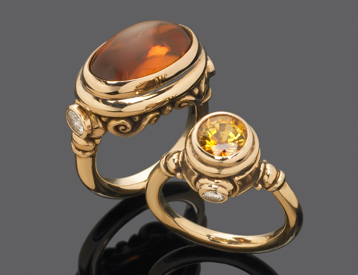 Custom & modified ring featuring orange zircon & diamond, golden sapphire & diamond.