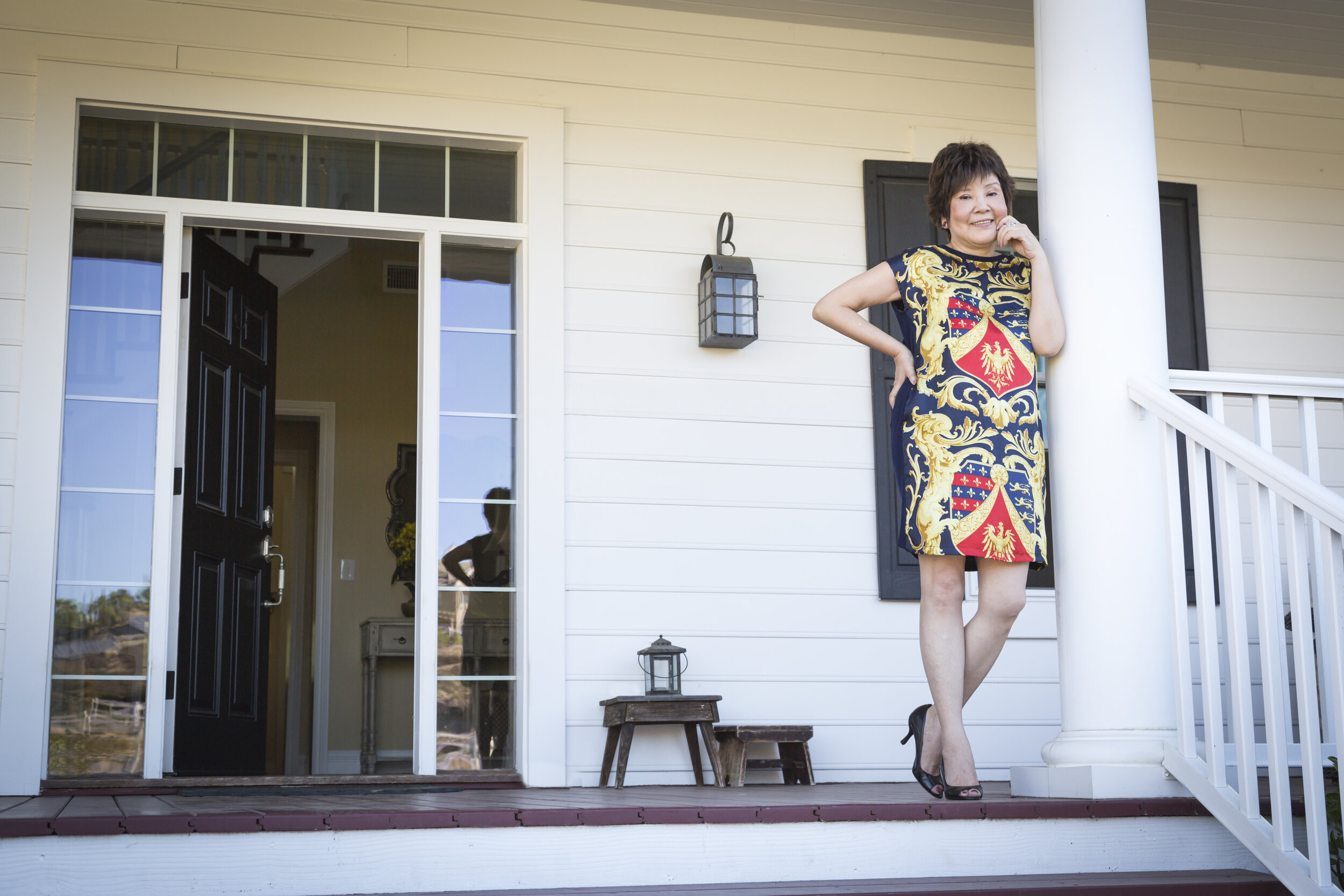 Attractive Chinese Woman On Her Front Porch
