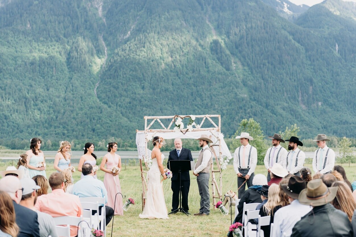 Bride and groom at their ceremony with a mountain backdrop