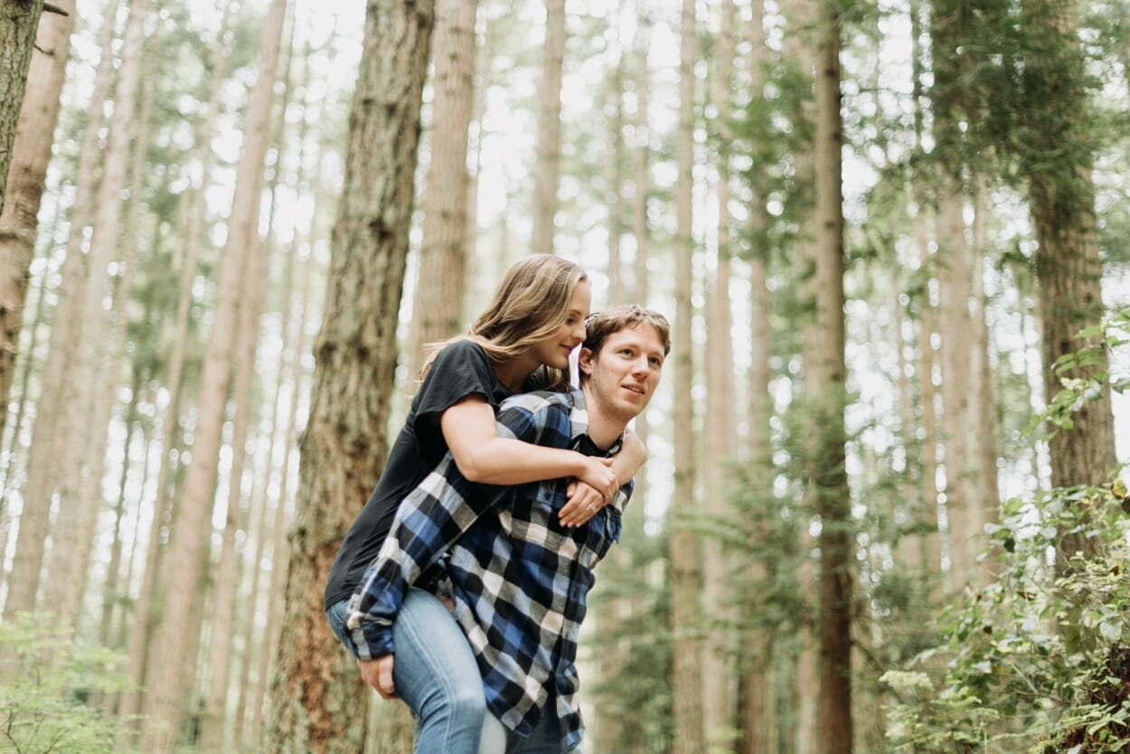 Man giving his fiancee a piggy back ride