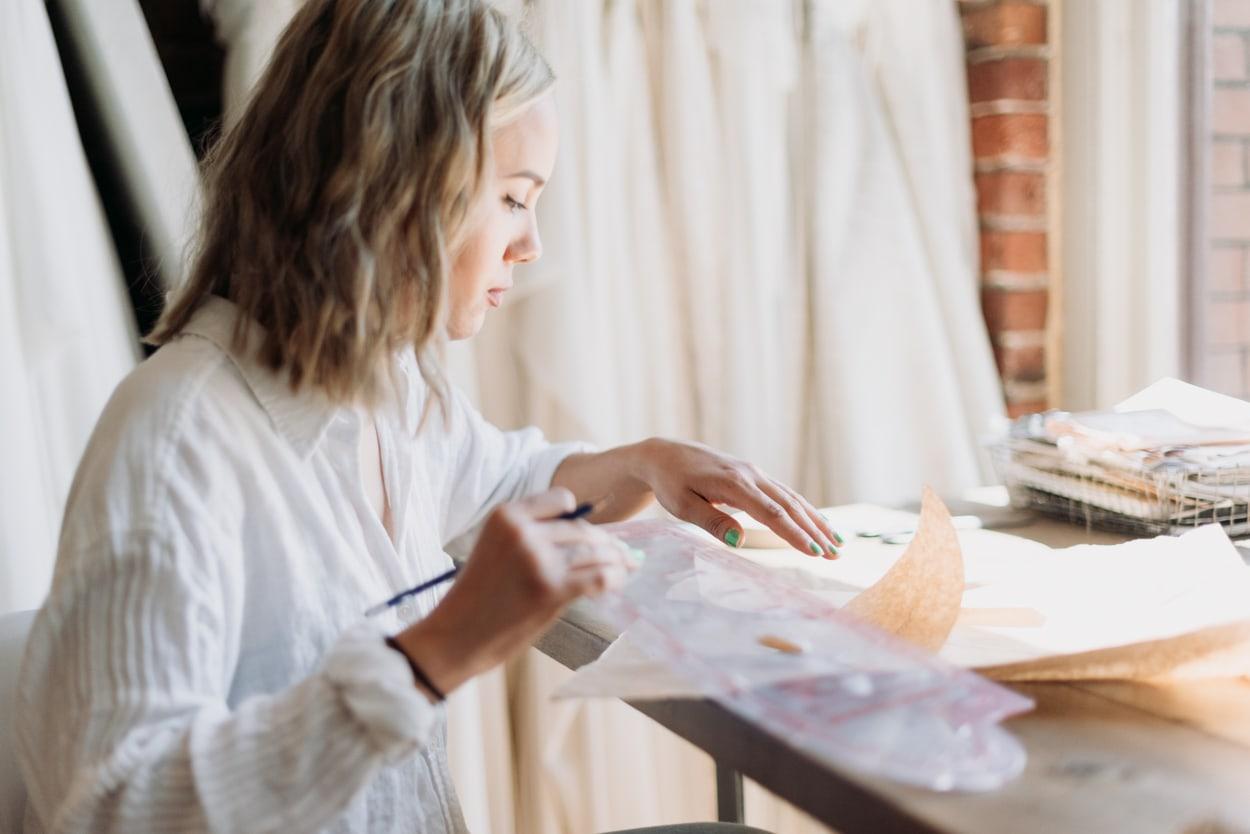 Designer working on wedding dress pattern