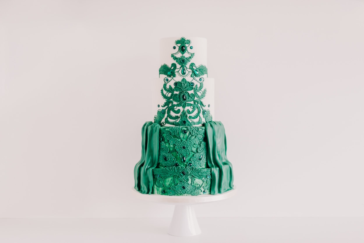 Three tier wedding cake with a green design