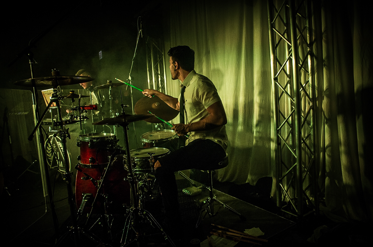 Drummer Rocky Roppo performing alongside DJ Daily at The DJ Firm's 2018 Showcase Event