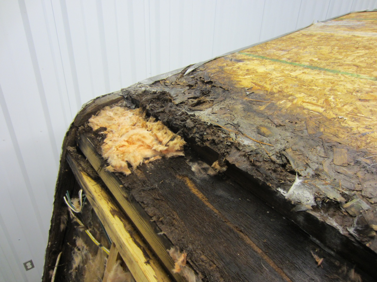 The wood and insulation was wet on the roof.