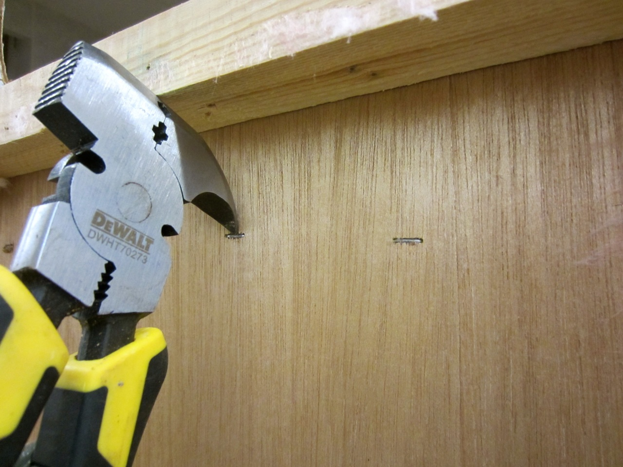 We had to remove all the staples that keep the cabinets attached to the walls. Go get yourself a pair of fencing pliers!