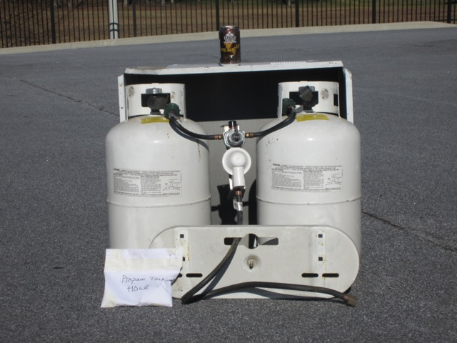 Propane tanks, brackets and regulator: 123.5 lbs (tanks alone are 93.5 lbs, tanks are about half full)