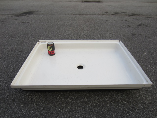 Shower pan: 9.5 lbs (will replace with a new corner shower pan)