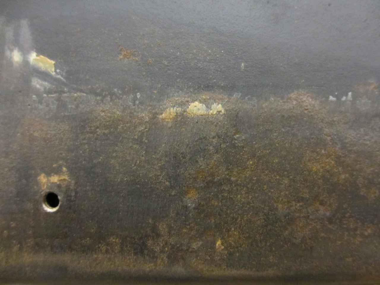 Although the really chunky rust is removed, you can see there's still rust in the divots. That's where the rust ate the metal and it also needs to be removed.