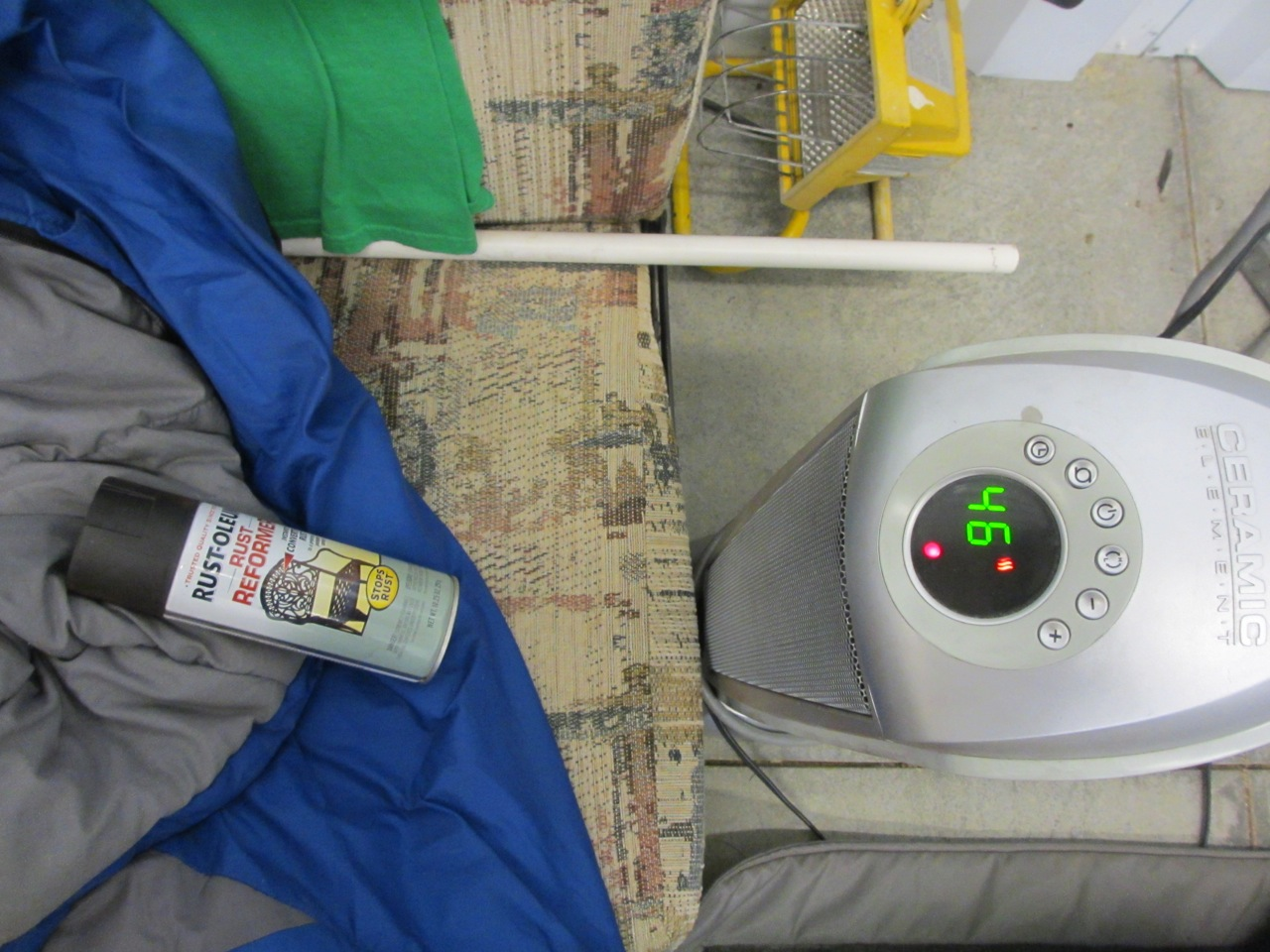 The Rust-Oleum has to be around 55°degrees to use. So we had to warm it up in front of the space heater.
