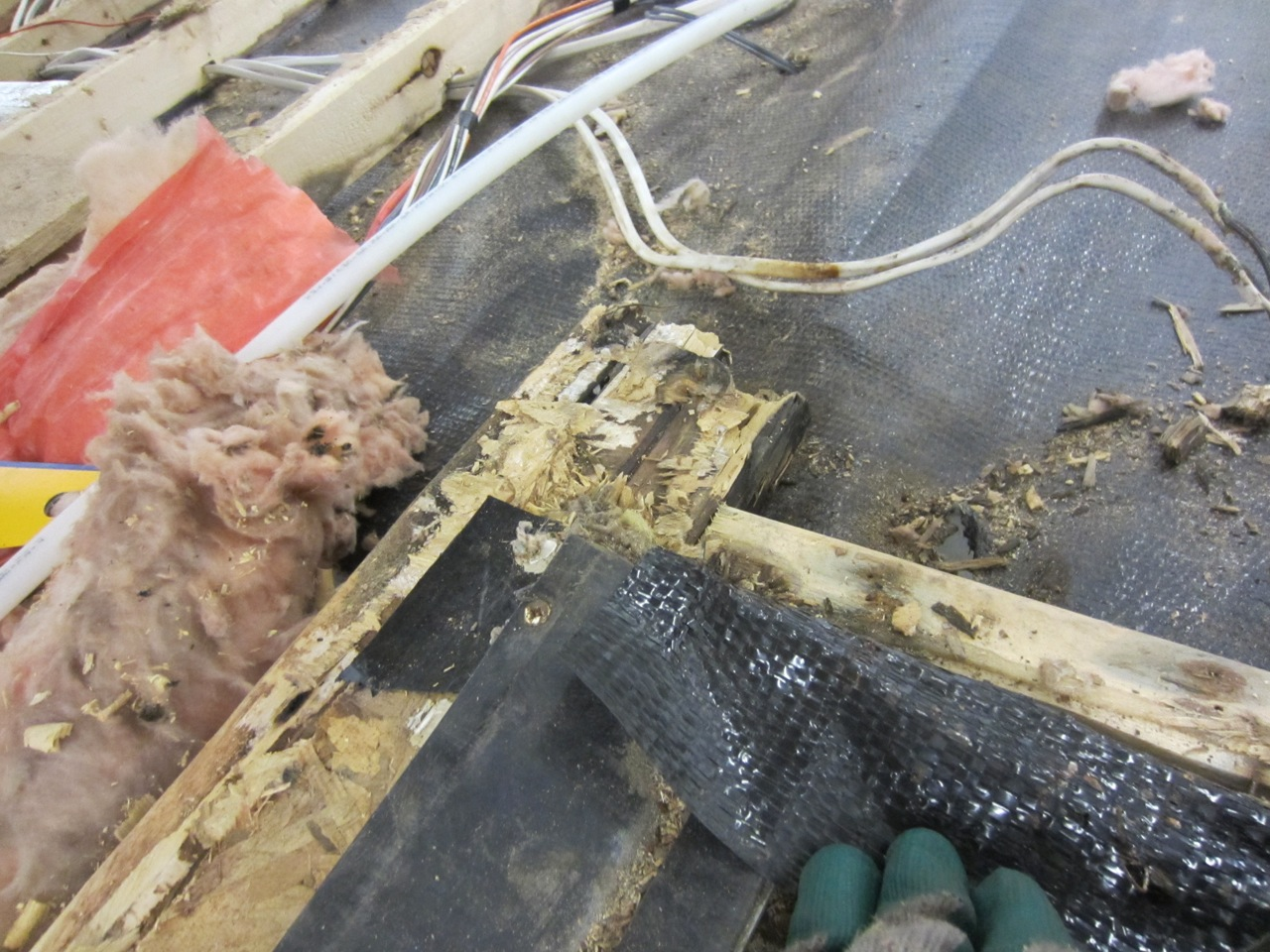 The floor joists are a mess from pieces of sub-floor boards that didn't fully come off.