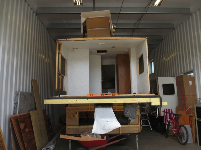 A view of the front of the trailer (bedroom) with the new sill plates installed on the chassis.