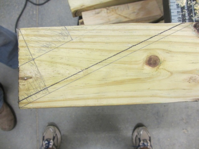 Jerud measured and marked 2x4s that will be the bottom front of our bedroom.