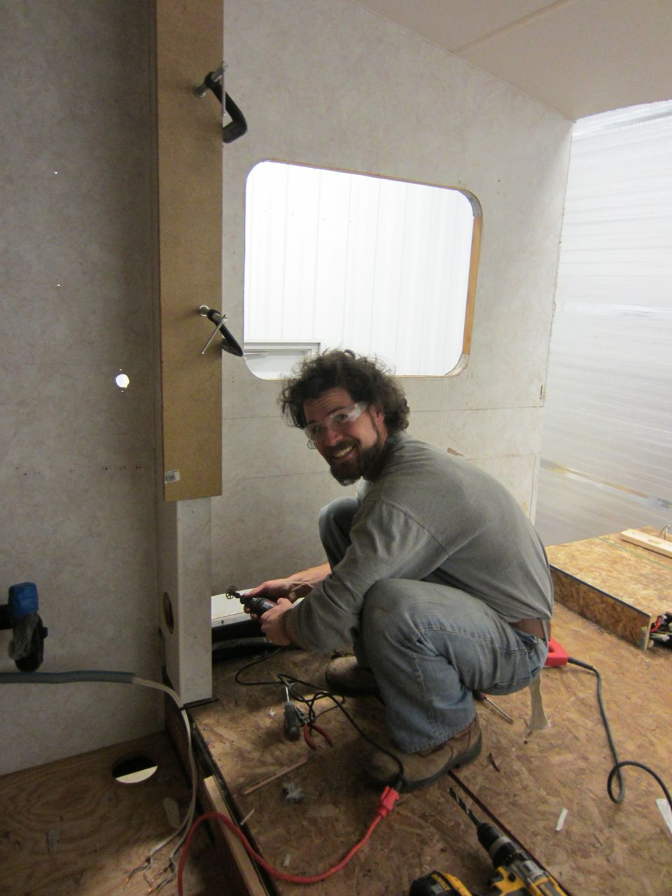 Jerud setting up to cut the divider wall out. Removing these two walls also means decreasing the overall RV weight!