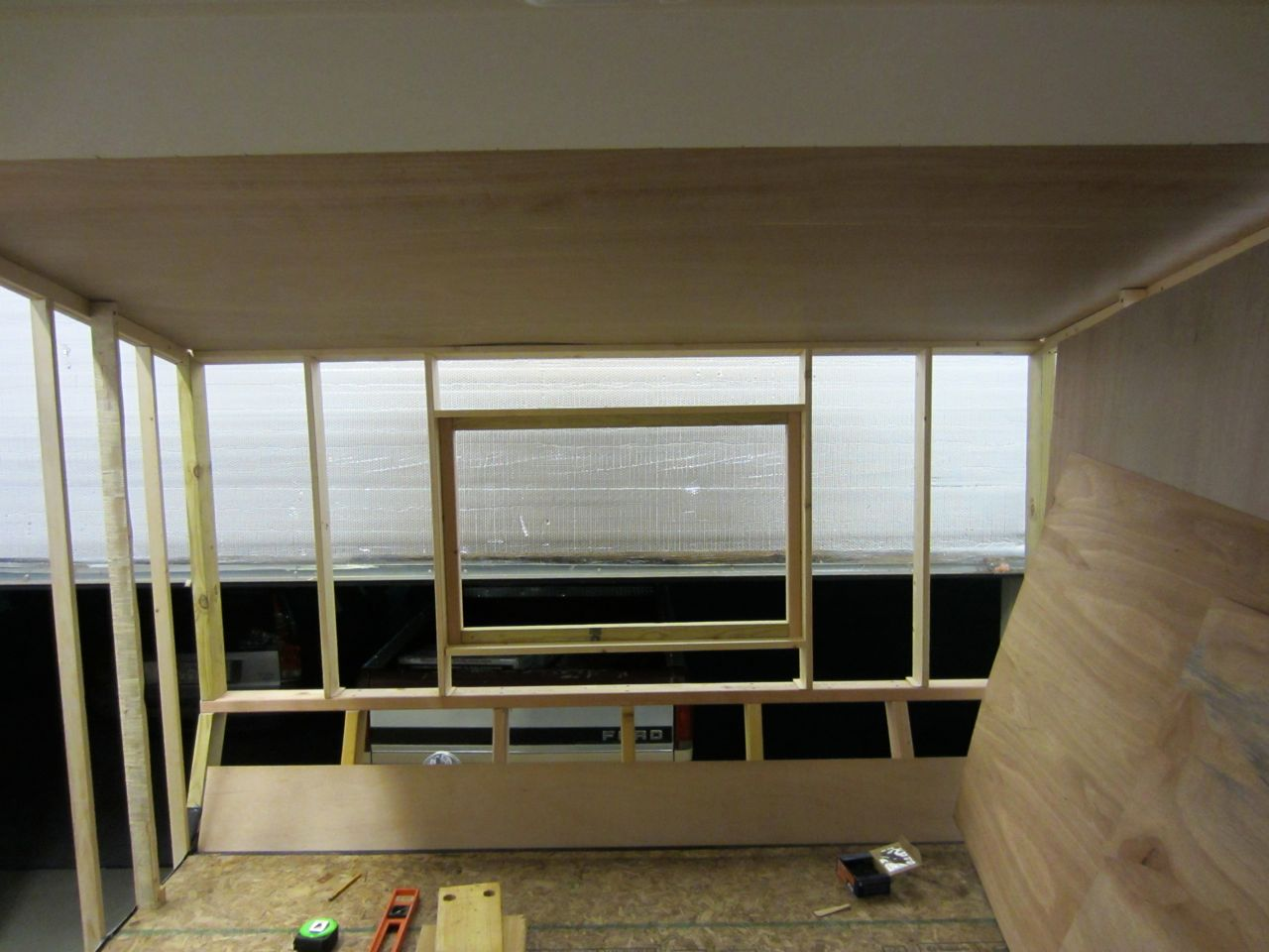 Window frame mounted into the front bedroom walls after we screwed in the front bedroom studs.