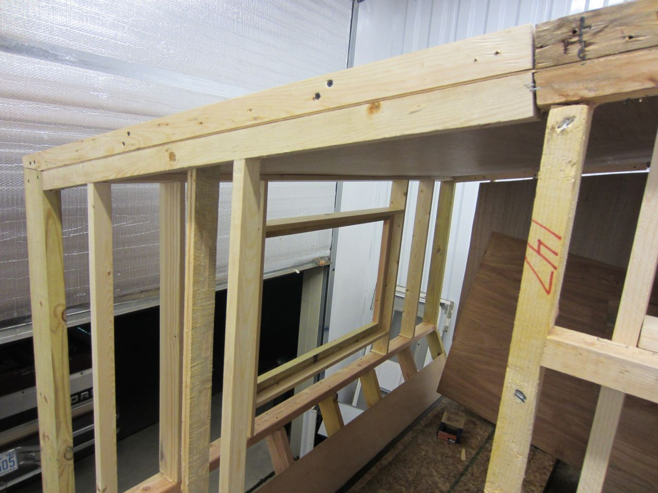 Side view of the roof frame. The luan is in-between the interior and exterior roof frame.