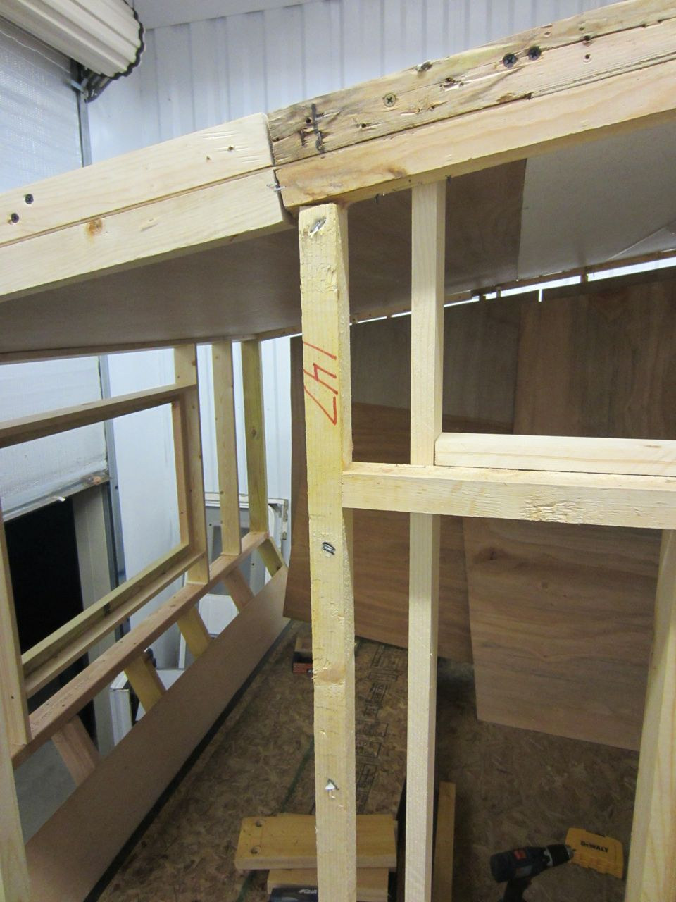 Here you can see the two layers of front window frames and the two layers of the side window frames built for the extra insulation. You can also where we connected the new roof to the old roof.