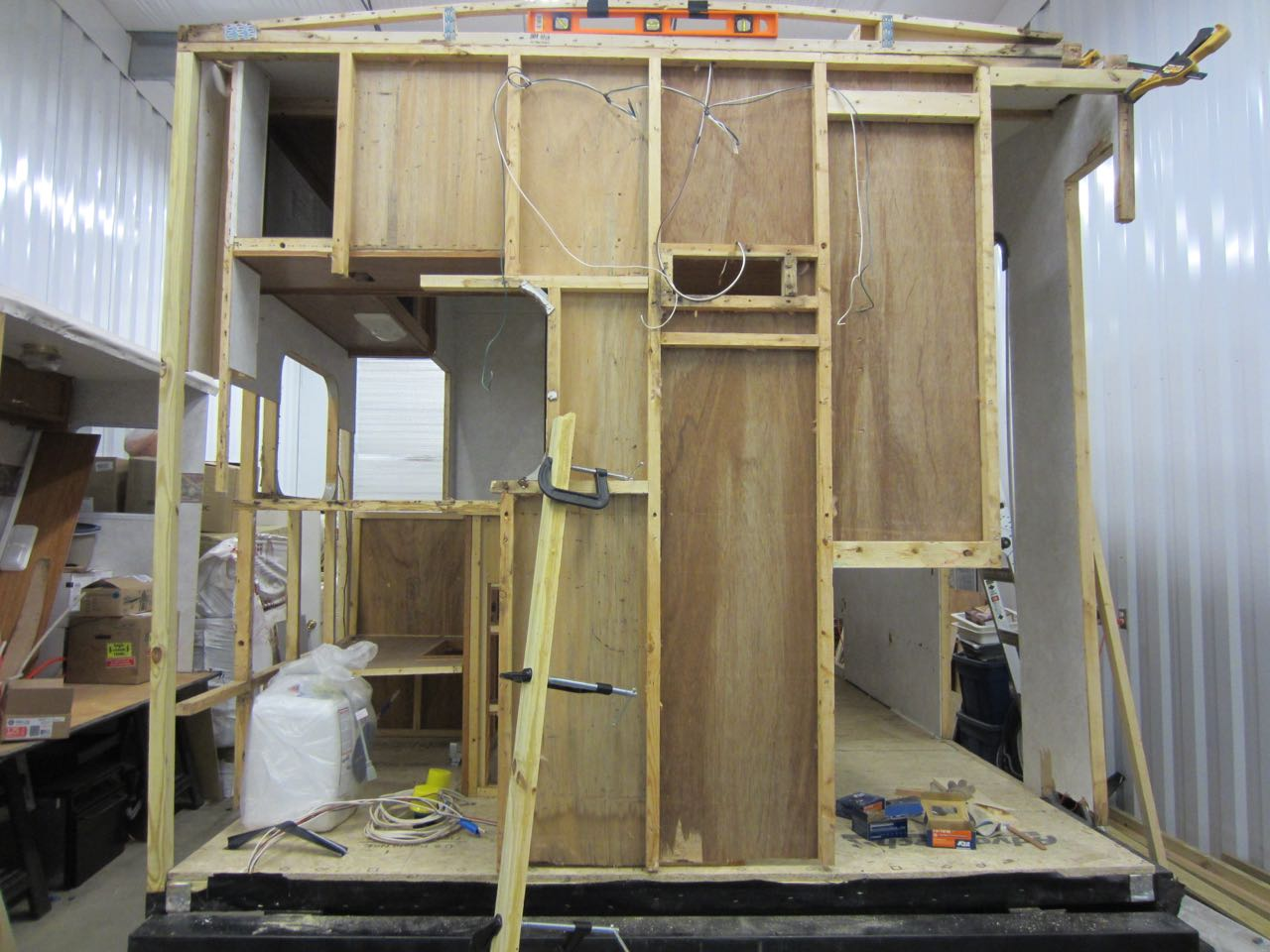 A new beam for the driver side of the trailer and the kitchen roof was installed.