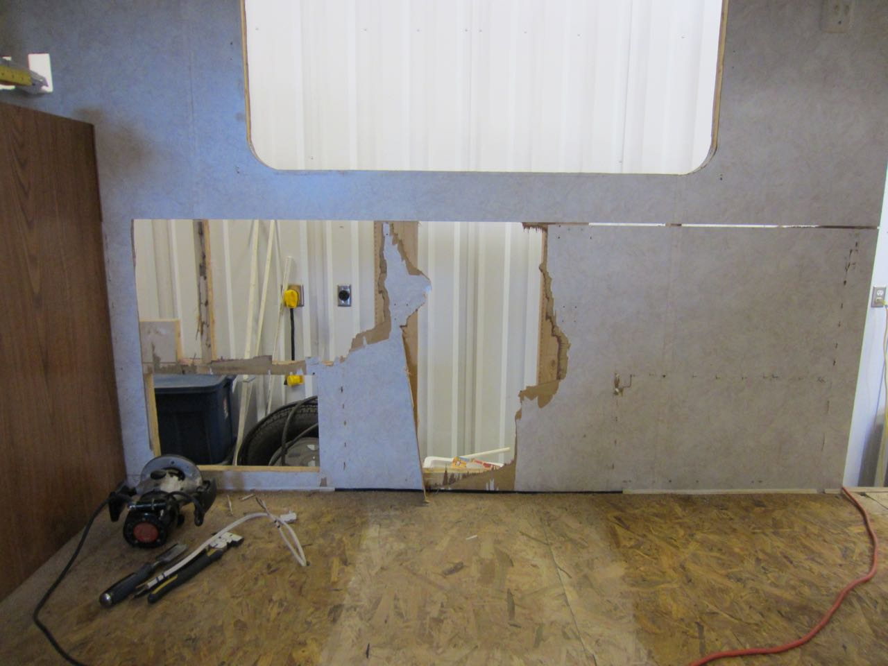 Some chunks of the walls had to be removed because the dinette was stapled into wall from the outside and the staples were buried deep into the wall. One of the holes is where there used to be a compartment.