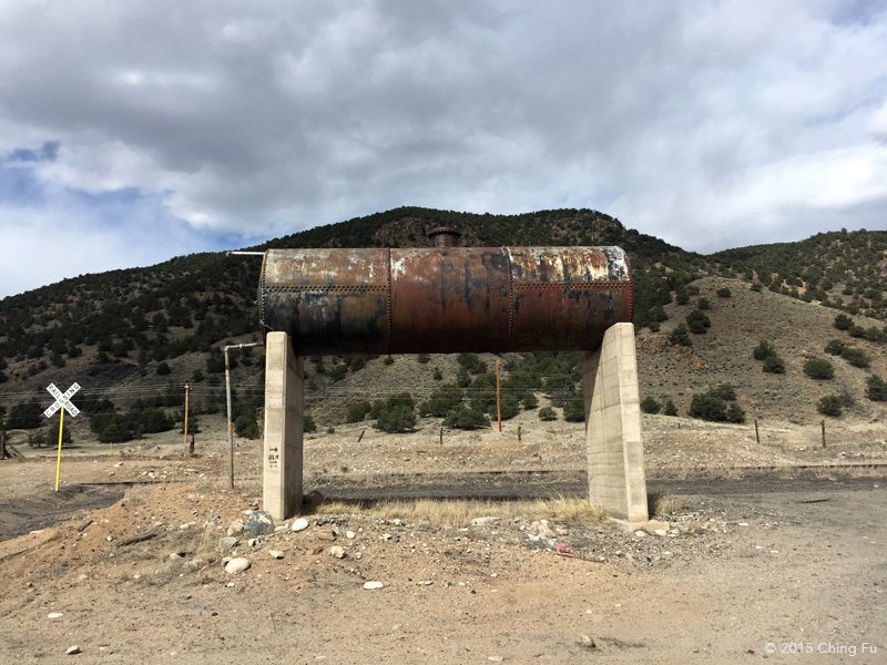 On CR 102 off Hwy 50 you will see this old tank with a tiny arrow painted on the concrete legs indicating BLM land is to the right.