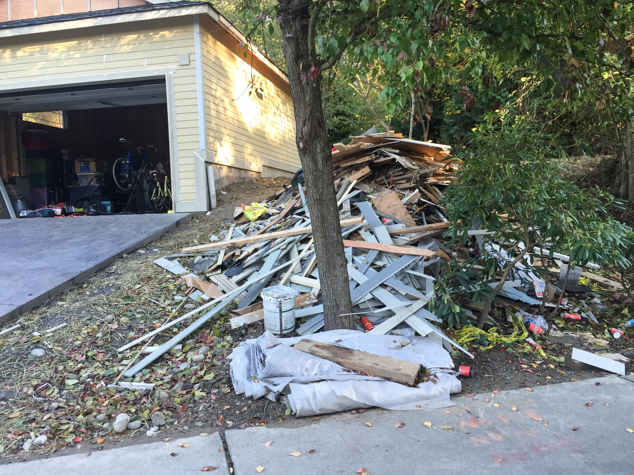 Neighbor's pile of discarded building materials.