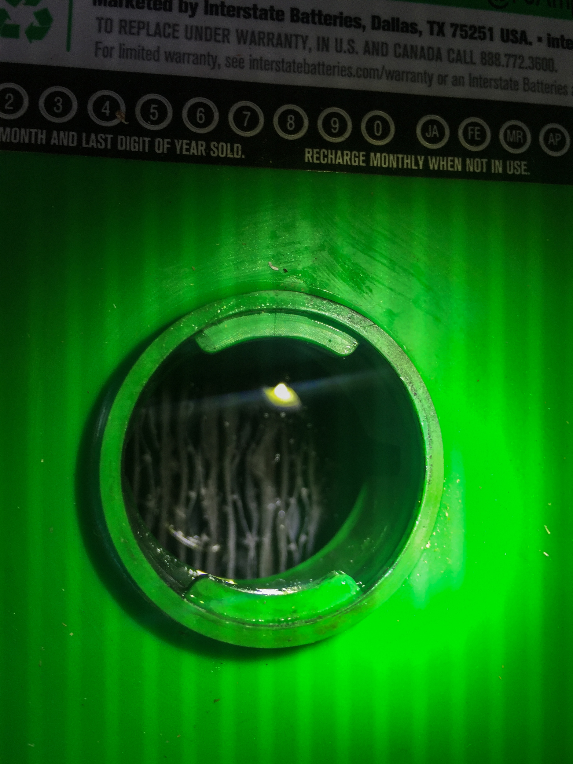 The view into a battery cap. See the lead plates in there?