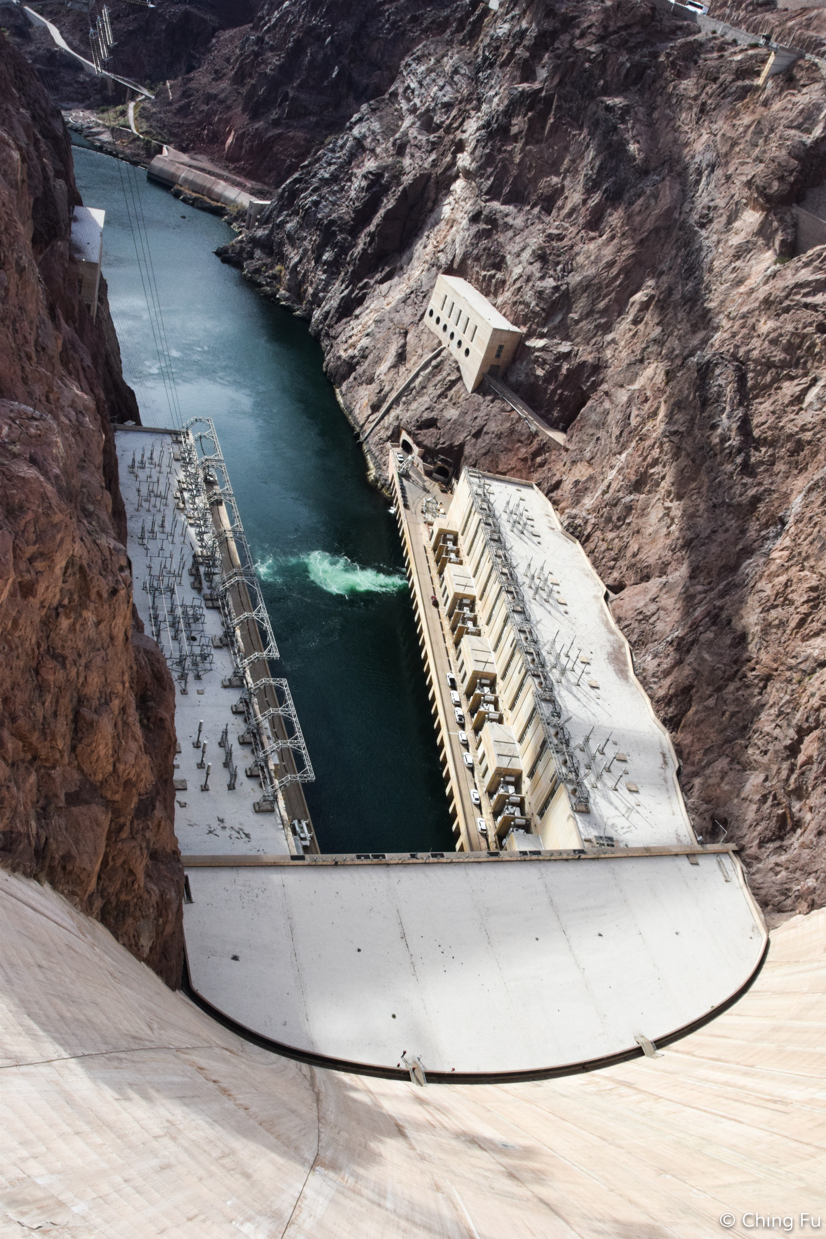 View of the Colorado River while standing at the top of the dam.
