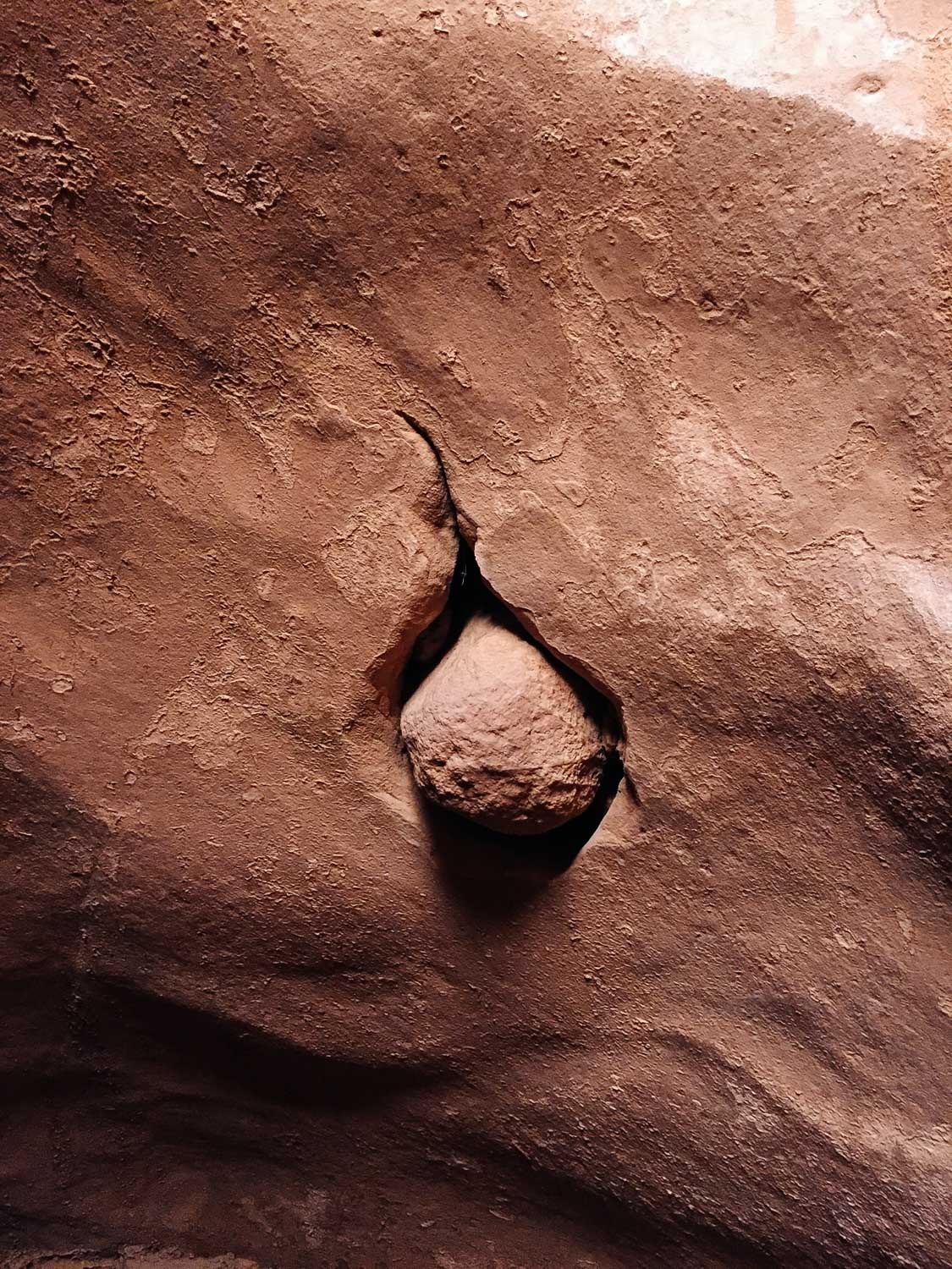 Rock stuck in a wall inside Lower Antelope Canyon.