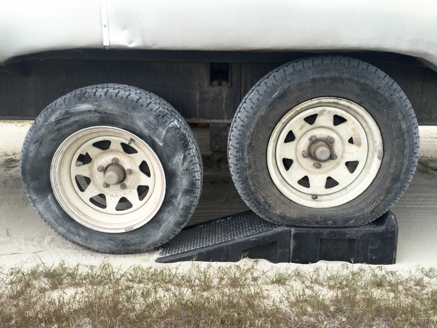 One of the trailer wheels on a ramp.