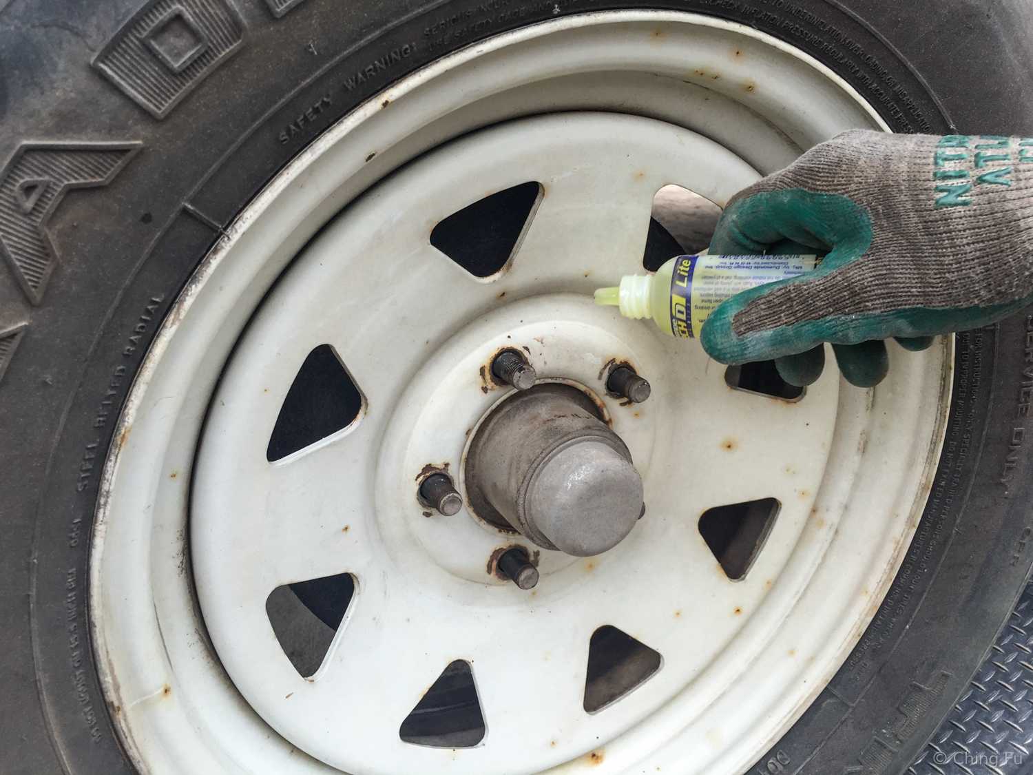 Step #10: Lube the studs before placing the lug nuts back on.