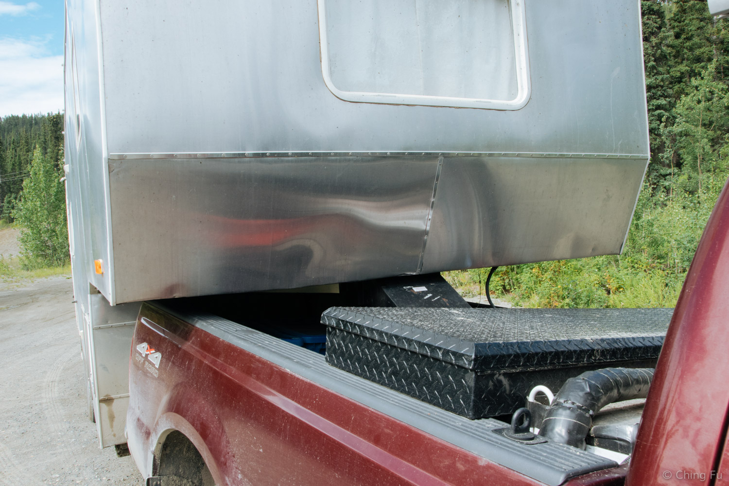 The truck's bed is within an inch of touching the trailer on the left side of this photo, but has a foot of gap on the right side. Blow it up and you can see some dents in the Toaster in those areas...