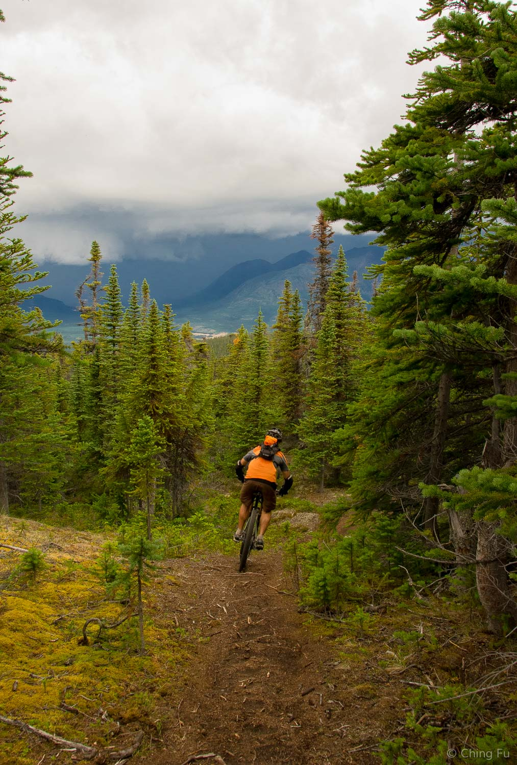 Riding down Nares View trail and into the storm.
