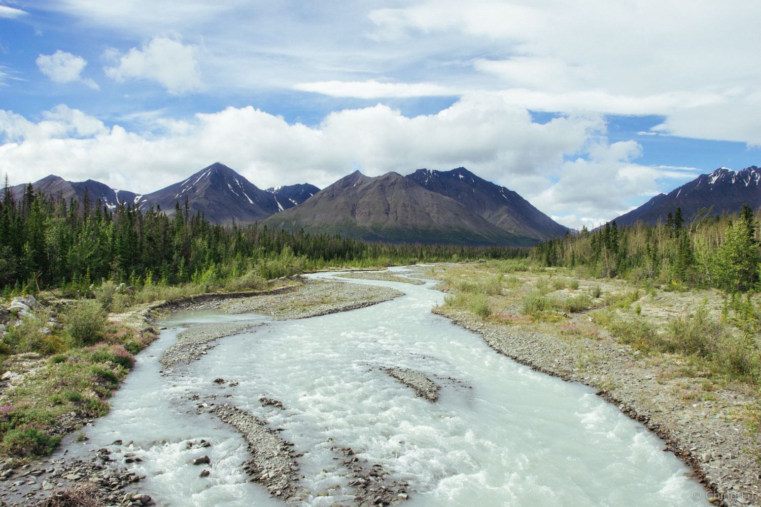 This is the view from Haines Highway of Quill Creek and the Auriol Range. Cars crossing the creek could see the Toaster tucked in the trees on the left riverbank if they looked at the right time.