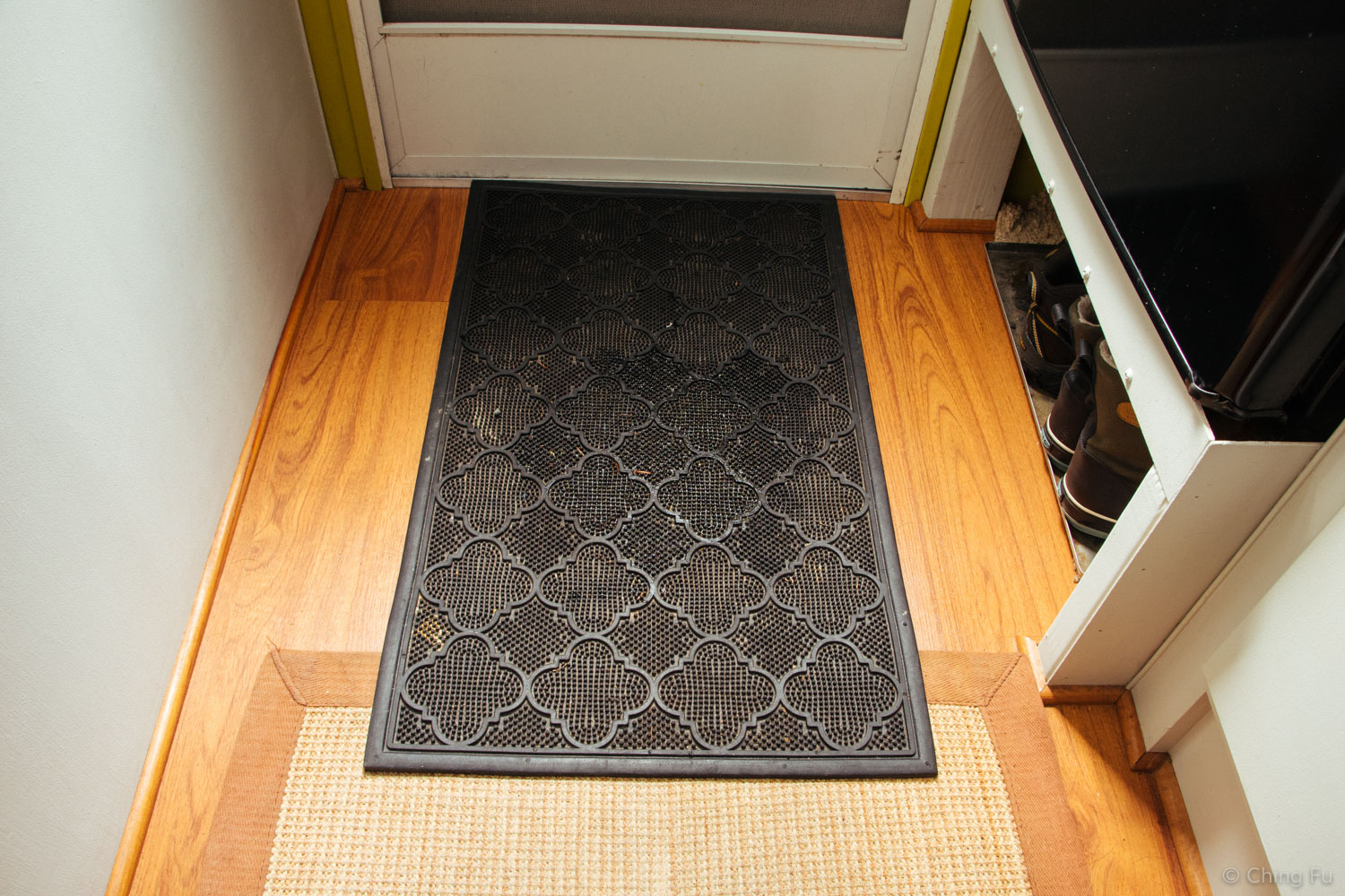 Rubber doormat to catch all the snow.